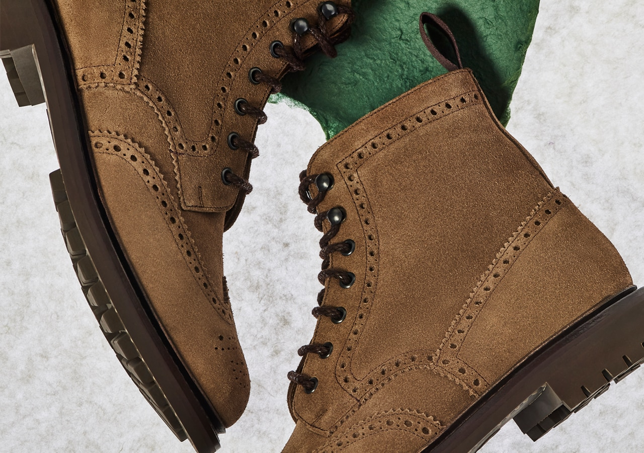 Close up of mens brown suede brogue lace up boots