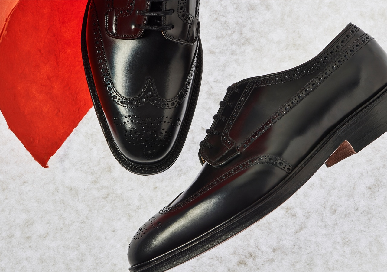 Close up of men's black brogue derby shoes