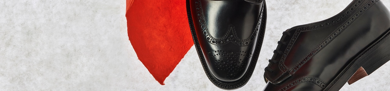 Black leather lace up brogues