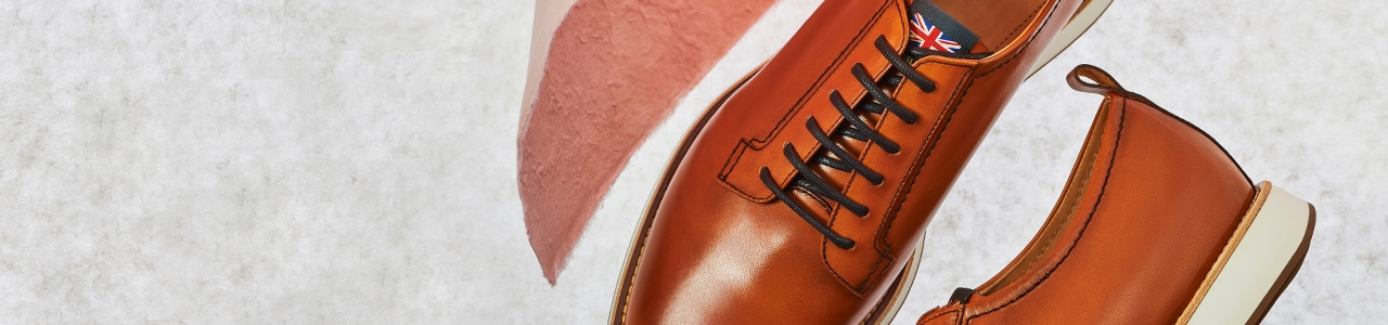 Brown leather lace up shoes with white sole